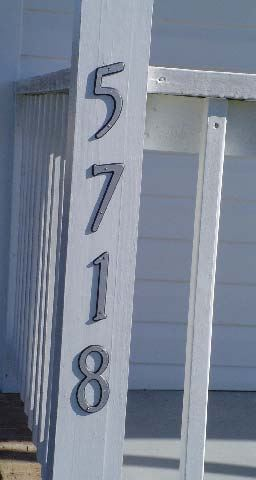 5718 address numbers on a porch edge