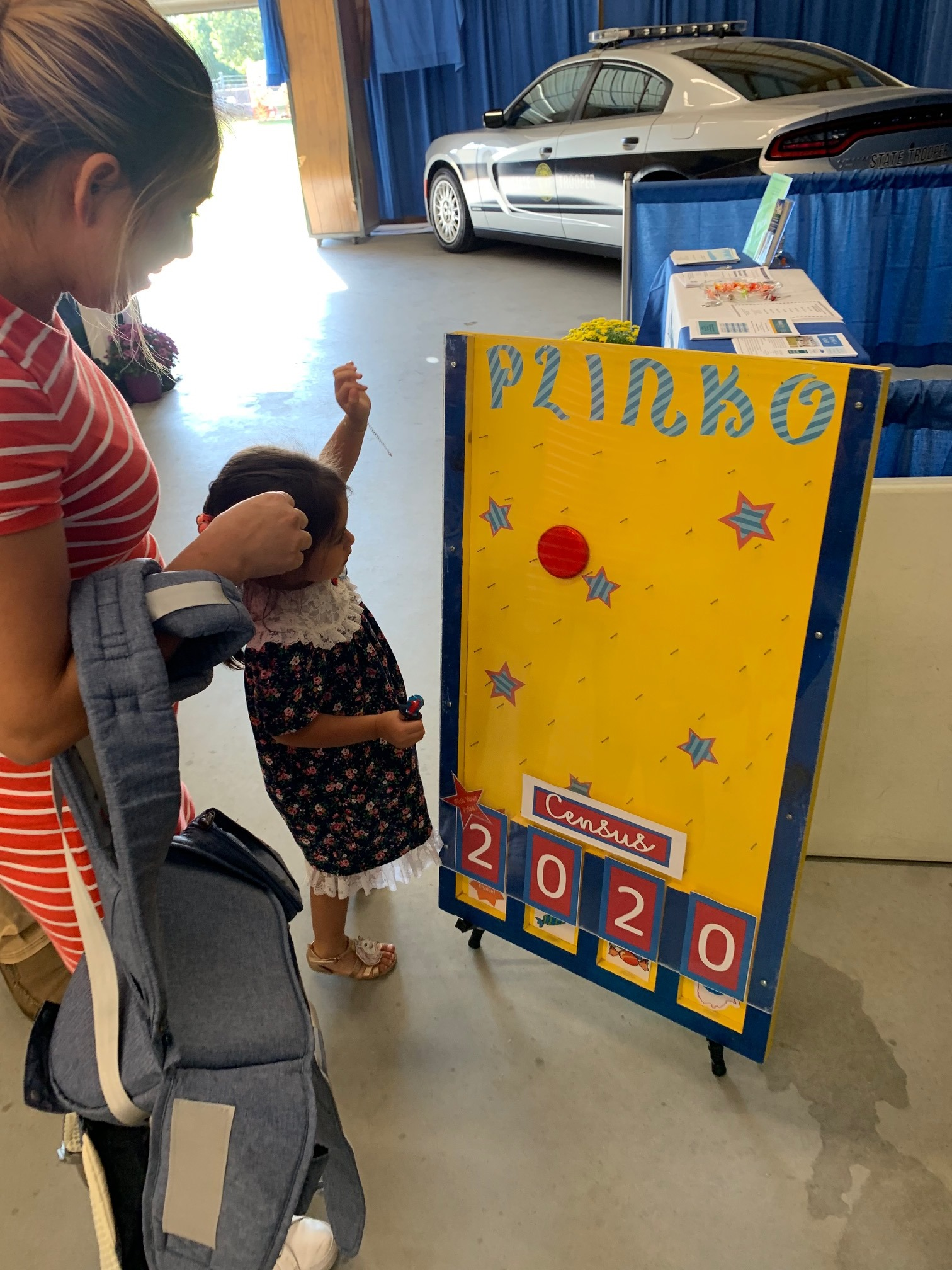 Small child playing Census 2020 Plinko game