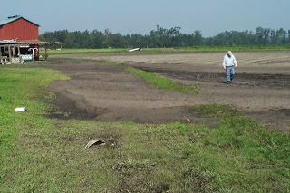 Picture of an open field of fresh plowed dirt