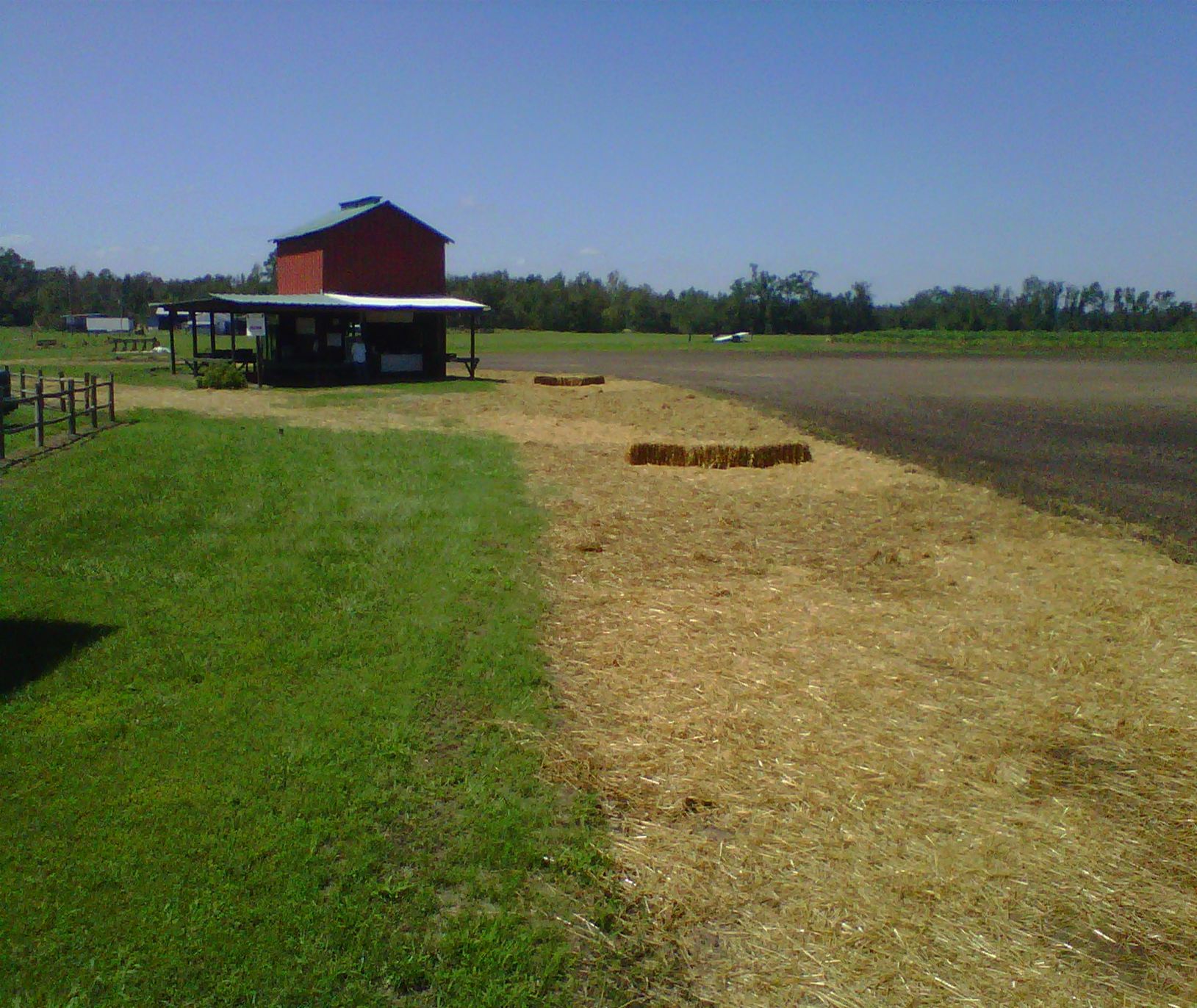 Picture of a field with hay spread over fresh dirt